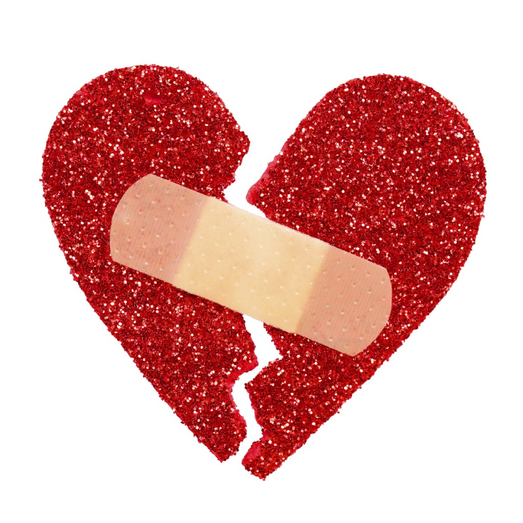 Broken Heart. Glitter ripped heart fixed with adhesive bandage i