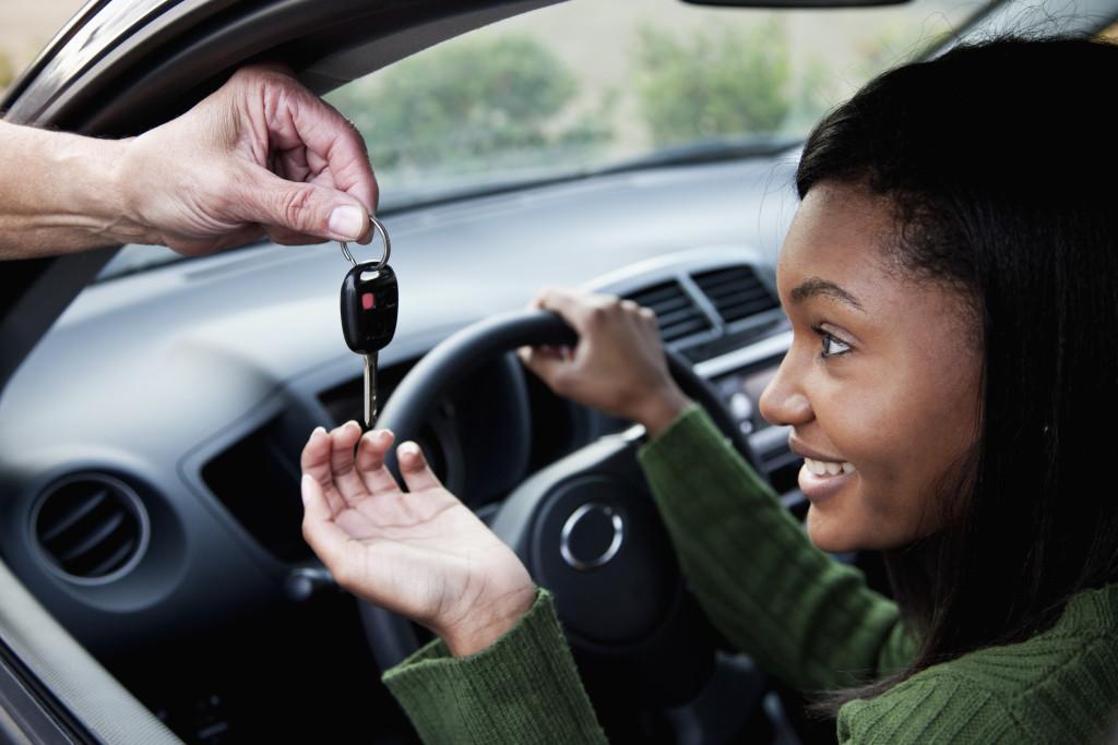 Driver takes the car key