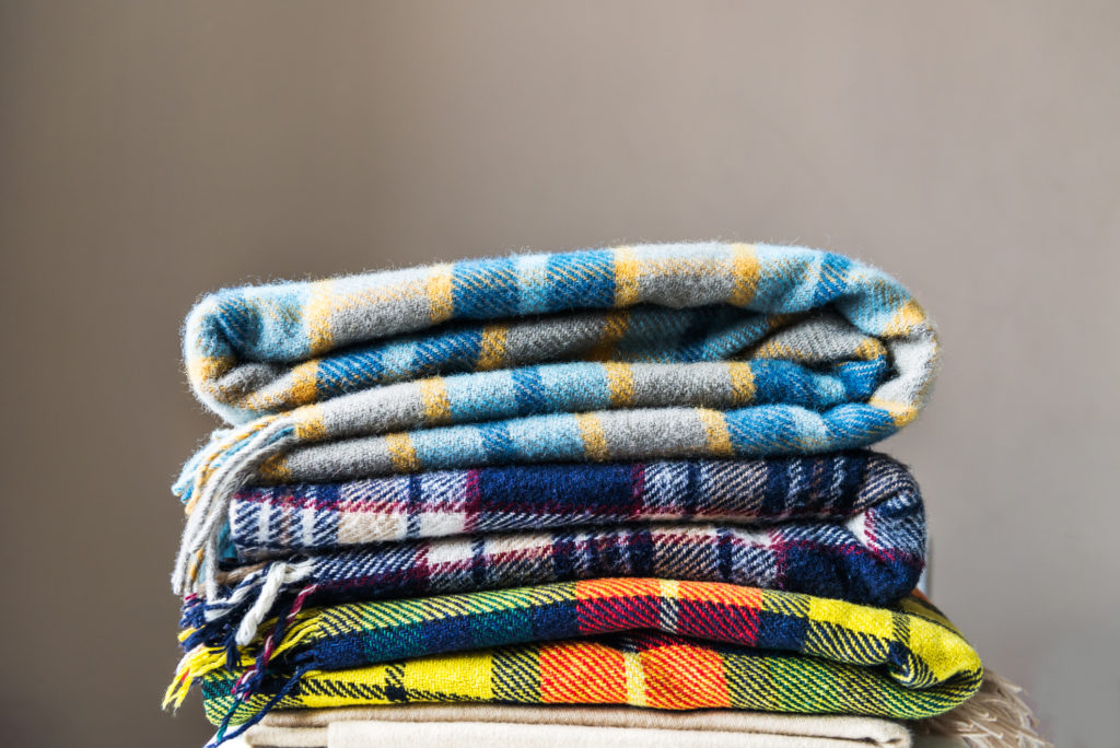 Stack of woolen checked blankets