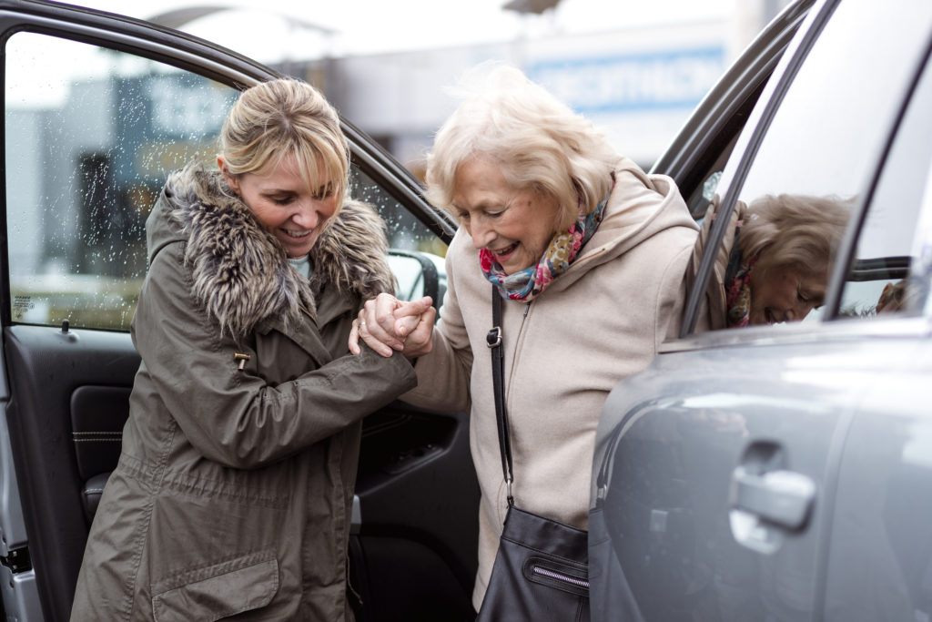 Helping a Senior Woman Out of the Car