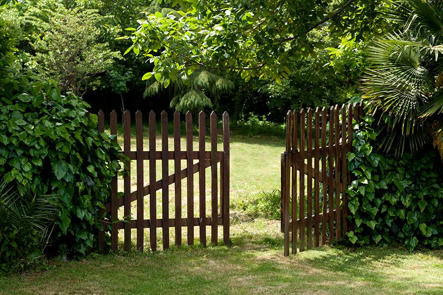 An open wooden gate